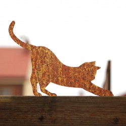 Rdzewiejący Kot Mizia na płocie